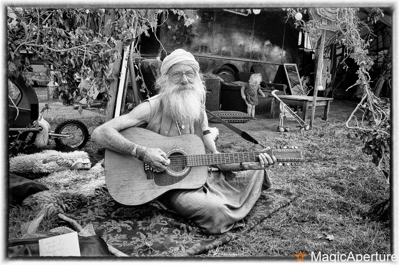 Old man playing the guitar